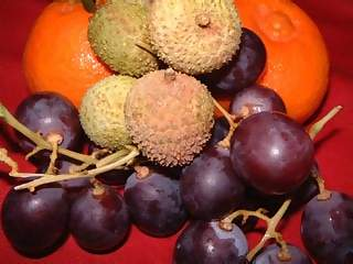 Food Photographs - Picture of Fruit basket of lychees tangerines and black grapes