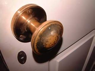 Household Photographs - Picture of Closeup of worn brass door knob
