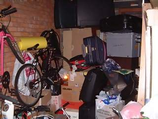 Household Photographs - Picture of Junk in garage including bikes and suitcases